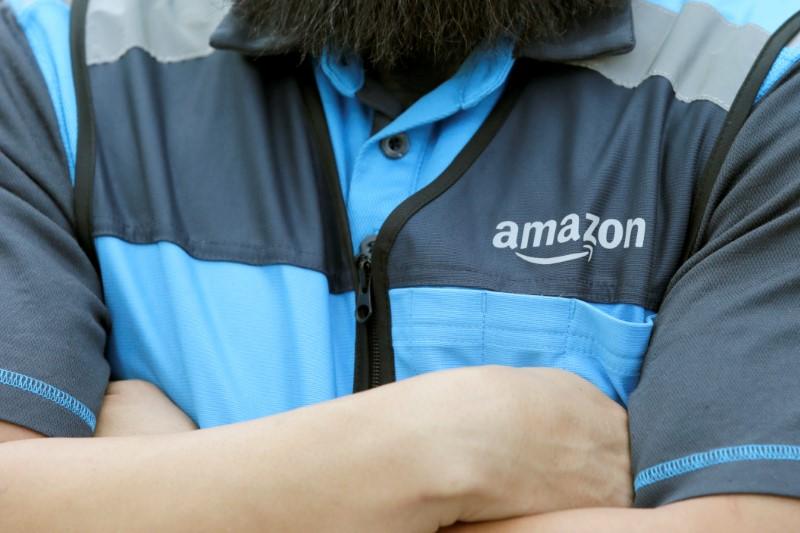 Joseph Alvarado makes a delivery for Amazon during the outbreak of the coronavirus disease