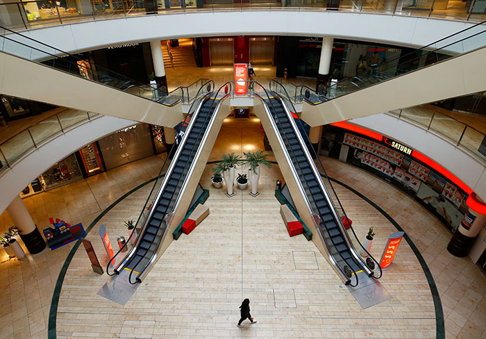 FILE PHOTO: A person is seen inside an empty shopping mall during a partial lockdown in