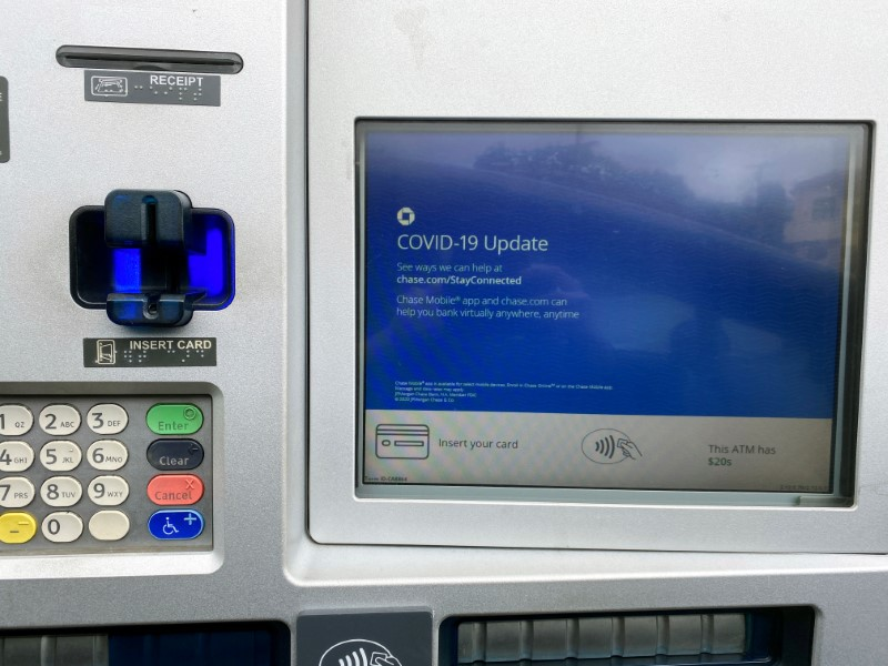 FILE PHOTO: A Chase bank drive-through ATM screen is seen with a COVID-19 message in Los