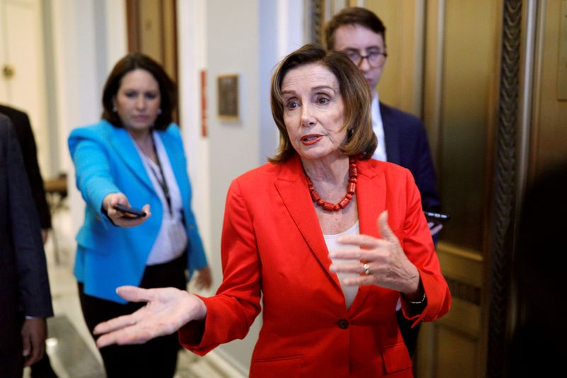 Speaker of the House Pelosi speaks to news reporters ahead of a vote on the coronavirus relief