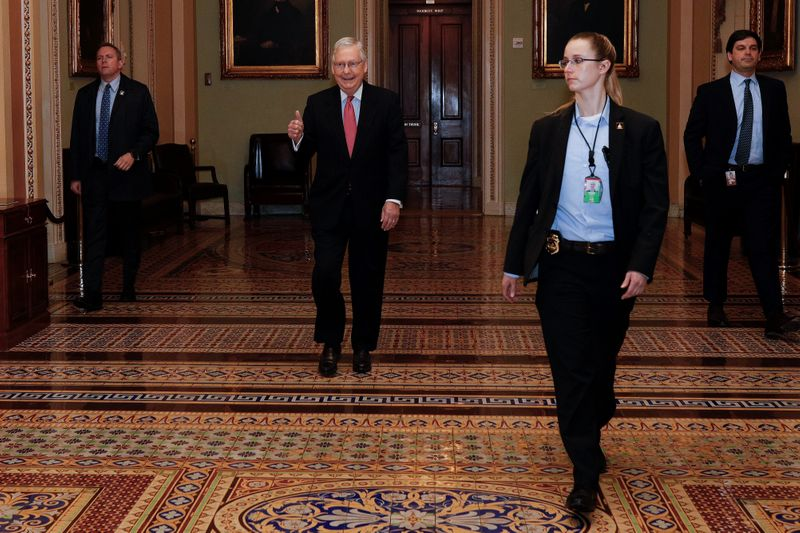 Republican Senators discuss the coronavirus relief bill ahead of a vote on Capitol Hill in