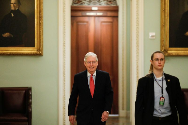 U.S. Senate Majority Leader McConnell enters the Senate Chamber Floor after Congress agreed to