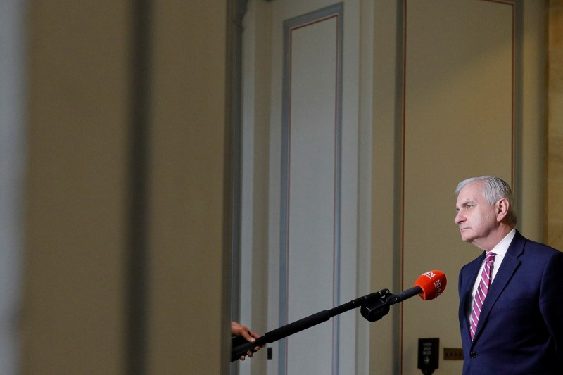 Senator Reed looks through a window between television news interviews, ahead of a vote on the