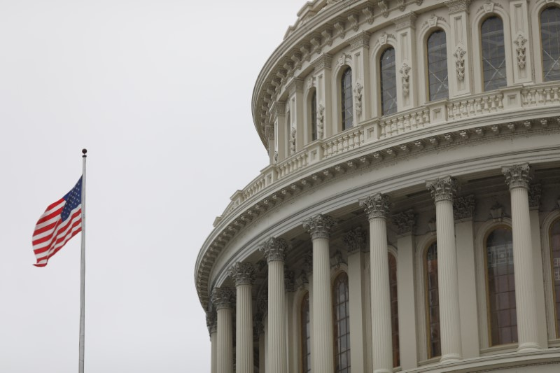 The U.S. Capitol during a morning rainstorm, after Congress agreed to a multi-trillion dollar