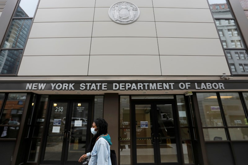 FILE PHOTO: A person walks by the entrance of the New York State Department of Labor offices,