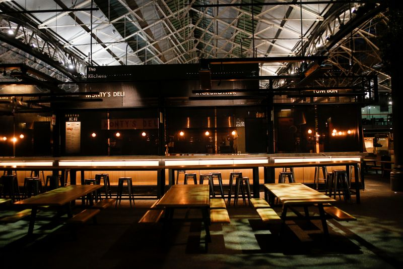 A couple walk through a deserted Covent Garden as venues close following growing number of