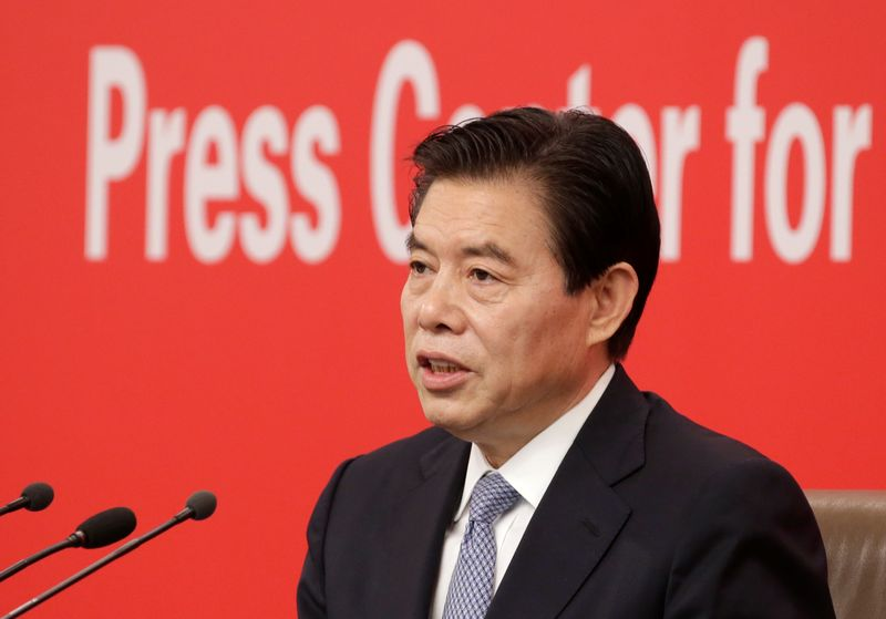 Chinese Commerce Minister Zhong Shan  attends a news conference in Beijing