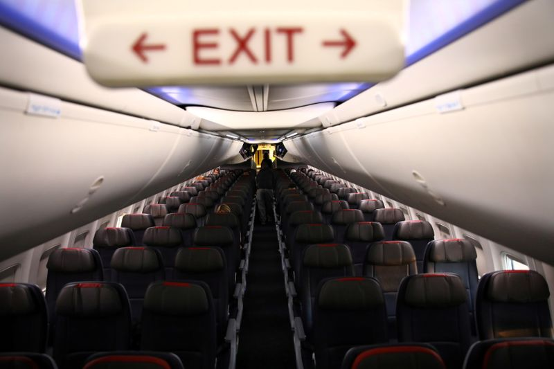 FILE PHOTO: Rows of empty seats of an American Airline flight are seen, as coronavirus disease