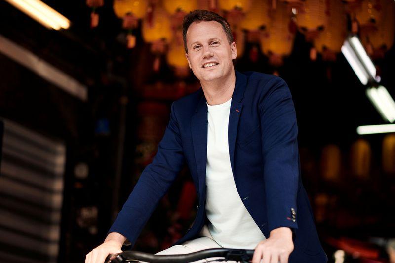 Ties Carlier, co-founder of Dutch electric bike maker Vanmoof, is seen on a bike