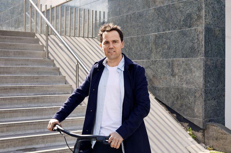 Taco Carlier, co-founder of Dutch electric bike maker Vanmoof, is seen on a bike