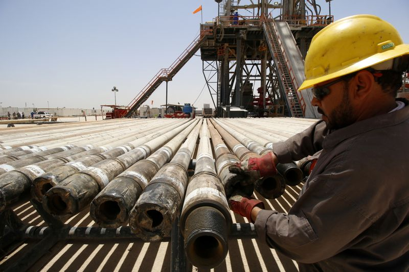 FILE PHOTO: A man works for Iraqi Drilling Company at Rumaila oilfield in Basra