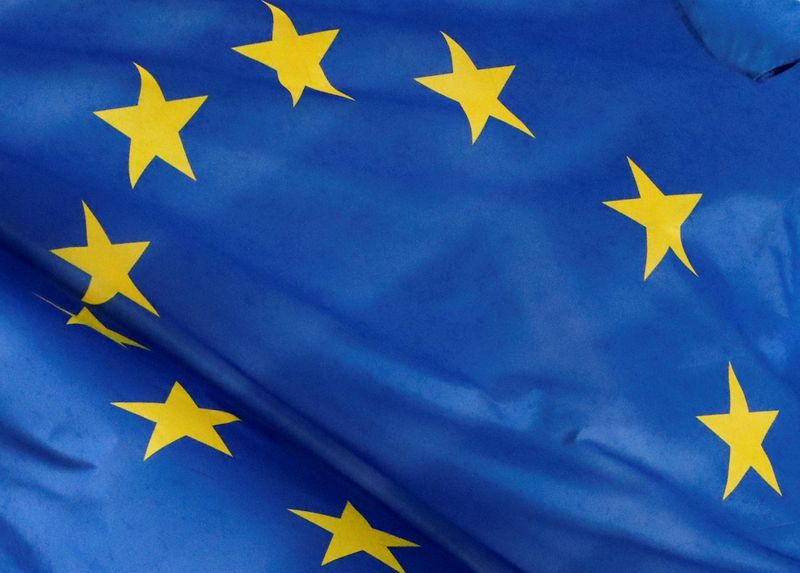 FILE PHOTO: A European flag is seen outside the EU Commission headquarters in Brussels
