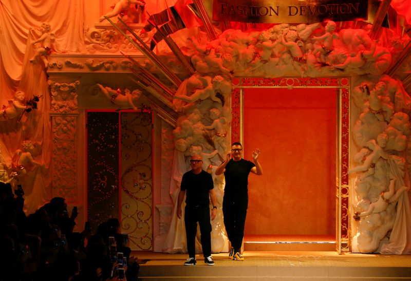 Italian designers Domenico Dolce and Stefano Gabbana acknowledge the applause at the end of