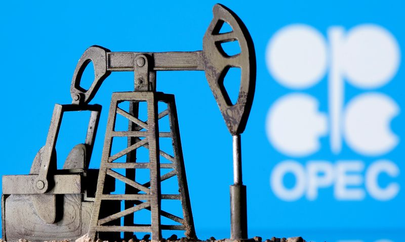 FILE PHOTO: A 3D printed oil pump jack is seen in front of displayed Opec logo in this