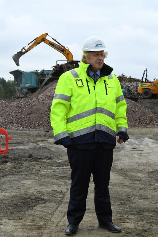 Britain's Prime Minister Boris Johnson visits the Speller Metcalfe's building site in Dudley