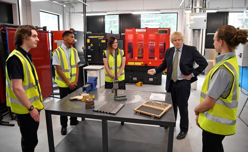 Britain's Prime Minister Boris Johnson delivers a speech during his visit to Dudley College of