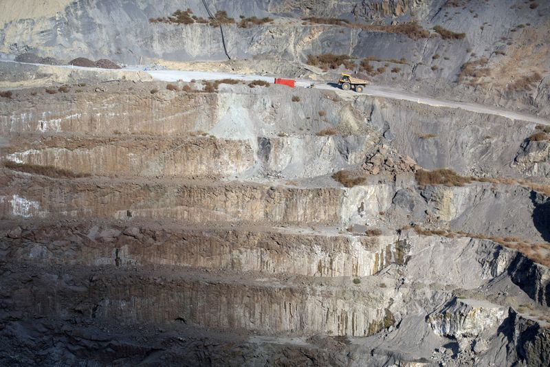 FILE PHOTO: A truck drives amongst workings at the De Beers Voorspoed Diamond mine near