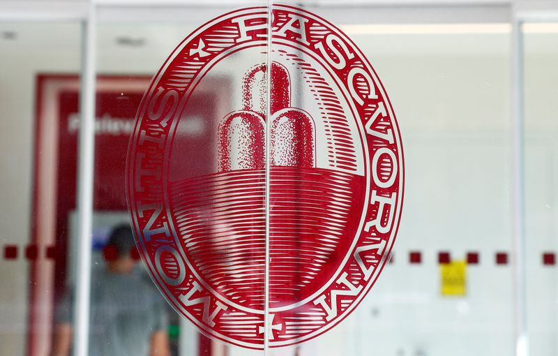 FILE PHOTO: The logo of Monte dei Paschi di Siena bank is seen at a bank entrance in Rome