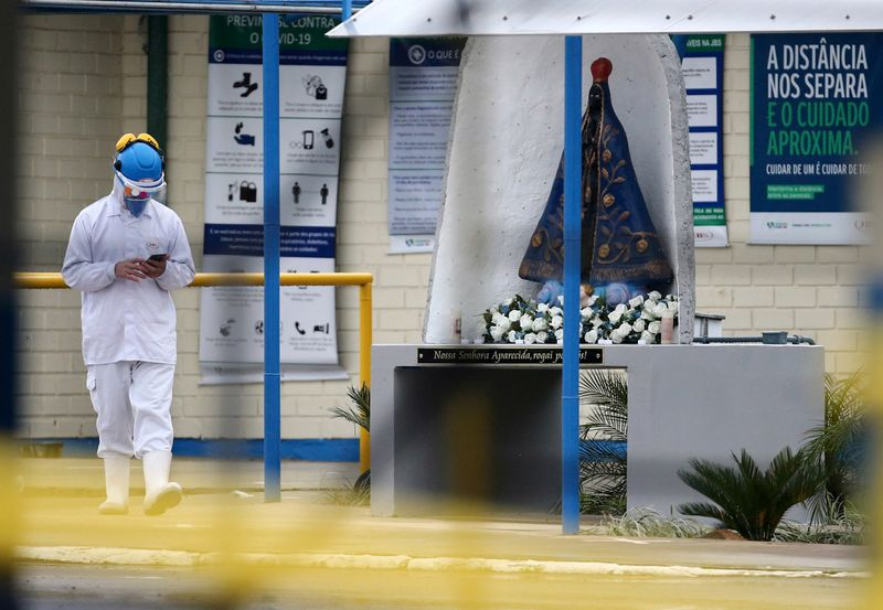An employee of the JBS SA poultry factory walks after the company was hit by an outbreak of the
