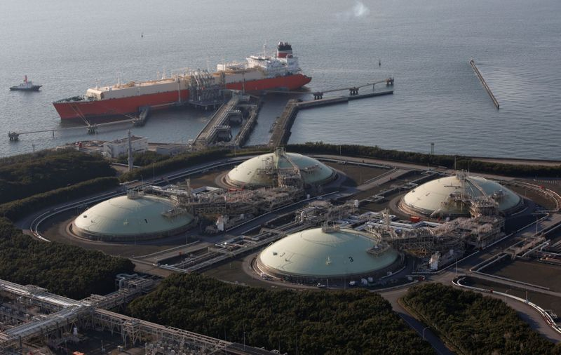 FILE PHOTO: Liquefied natural gas storage tanks and a membrane-type tanker are seen at Tokyo