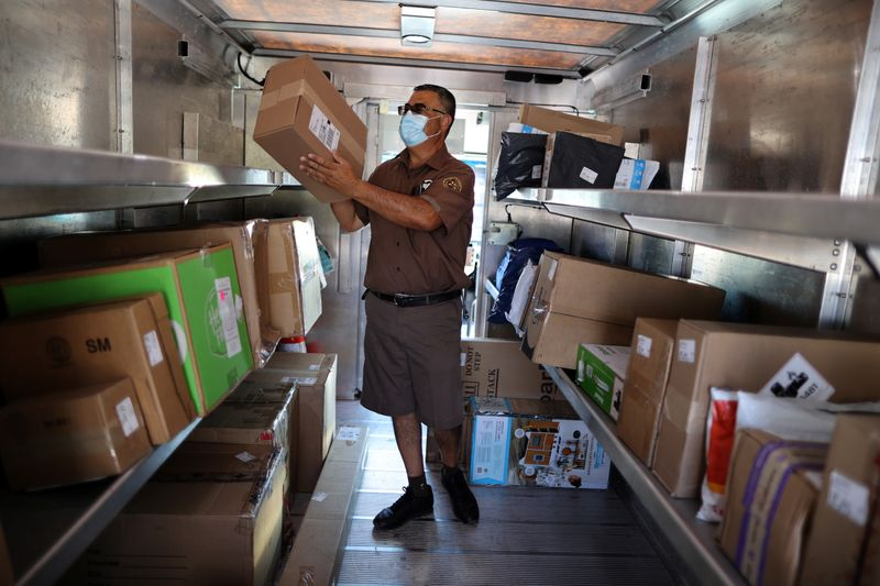 UPS Driver Gilbert Lopez works in an electric UPS truck, amid the global outbreak of the
