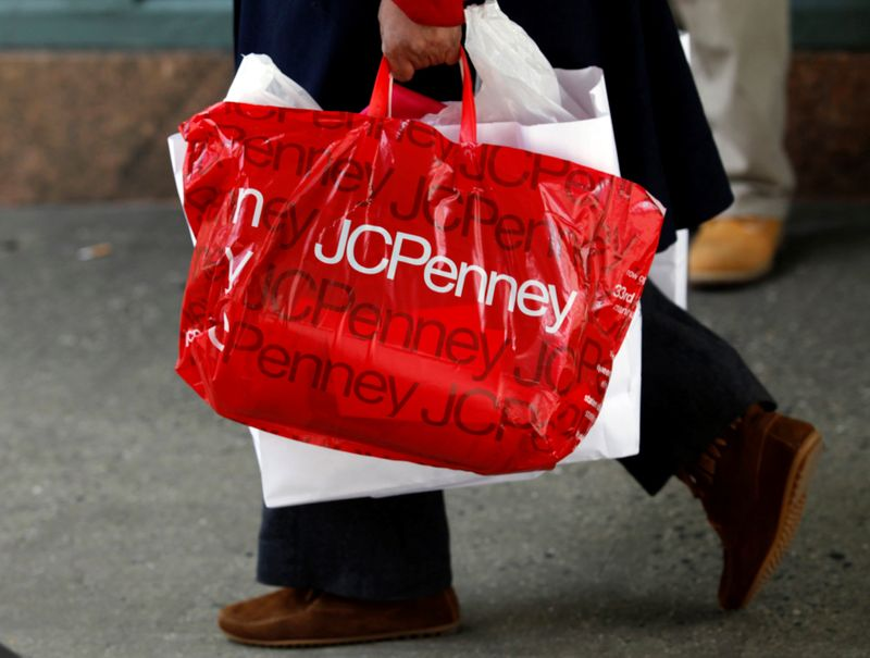 FILE PHOTO: A man with a Macy's bag walks past the J.C. Penney's store in New York