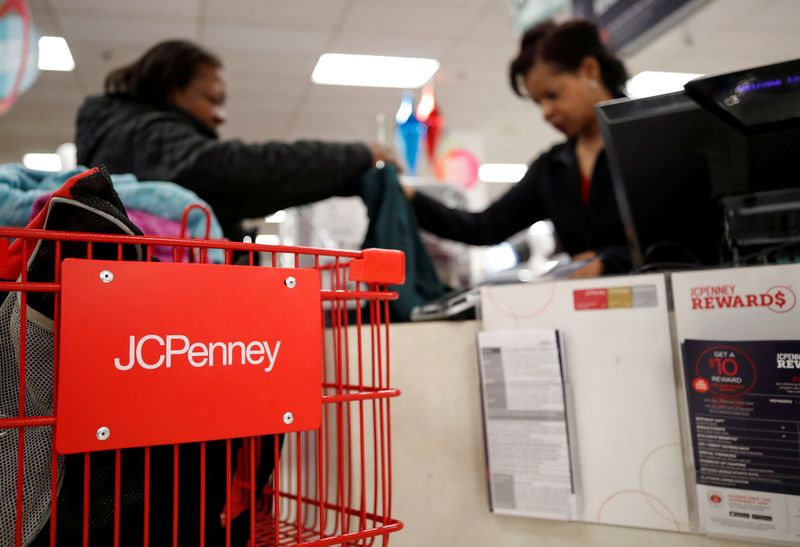 FILE PHOTO: A J.C. Penney employee helps a customer with her purchase at the J.C. Penney