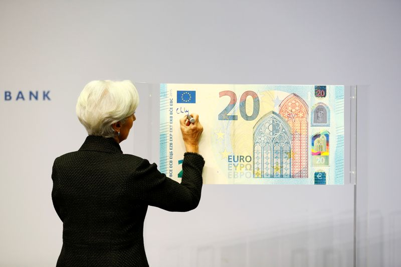 FILE PHOTO: European Central Bank (ECB) President Lagarde gives a signature for newly printed