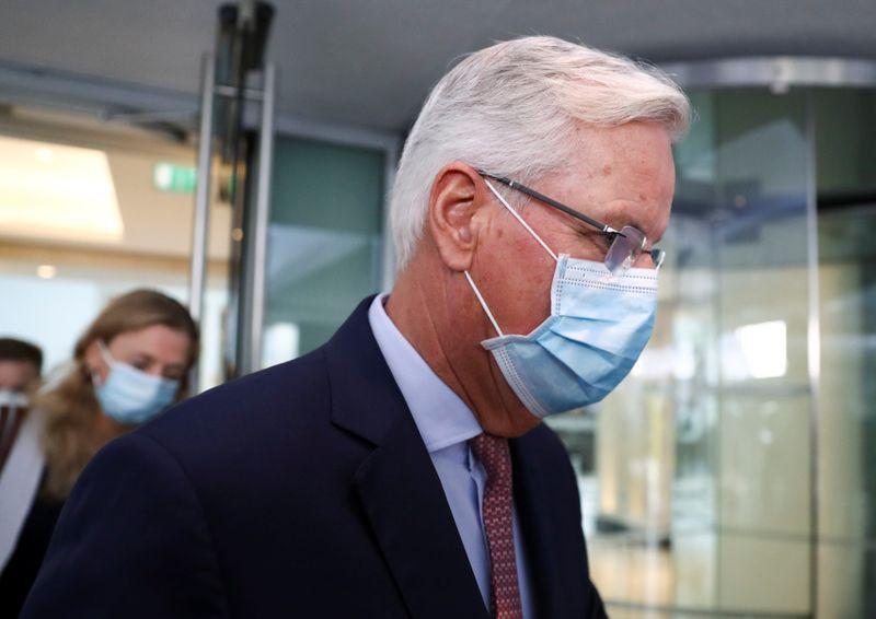 EU's Chief Negotiator Michel Barnier leaves a hotel in London