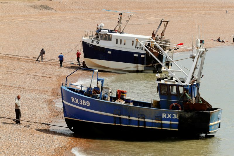 Fishing boats and fisherman in Hastings