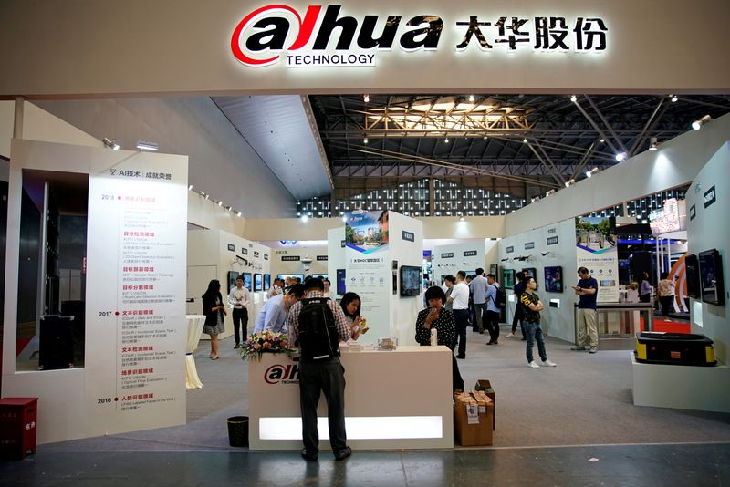 FILE PHOTO: People visit a Dahua Technology booth at a security exhibition in Shangha