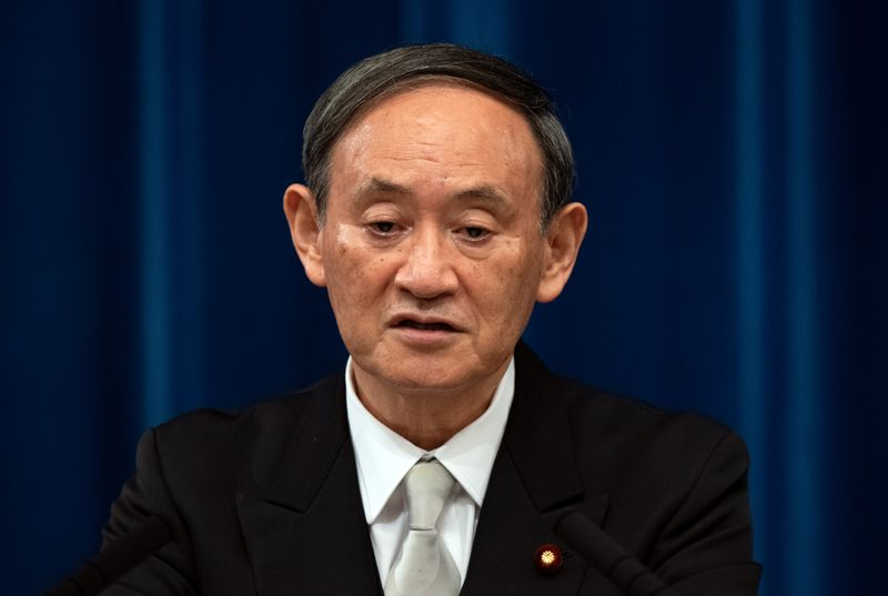 Yoshihide Suga speaks during a news conference following his confirmation as Prime Minister of