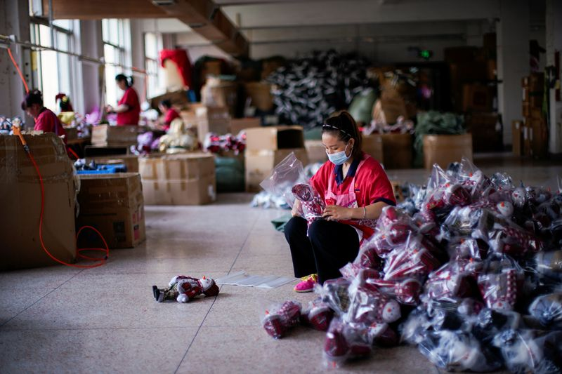 Employees make Christmas products at Fuye toy factory following the coronavirus disease