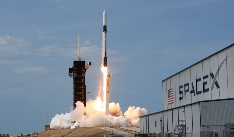 FILE PHOTO: A SpaceX Falcon 9 rocket and Crew Dragon spacecraft carrying NASA astronauts