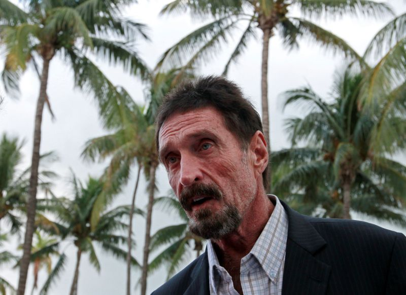 FILE PHOTO: Computer software pioneer McAfee speaks with reporters outside his hotel in Miami