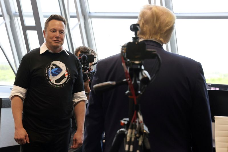 FILE PHOTO: U.S. President Donald Trump and Elon Musk are seen at the Firing Room Four after