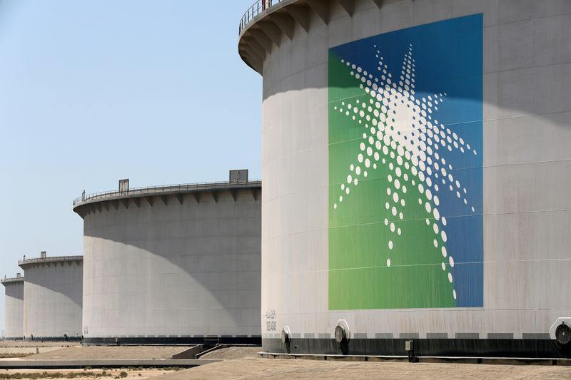 FILE PHOTO: Oil tanks are seen at Saudi Aramco's Ras Tanura oil refinery and oil terminal in