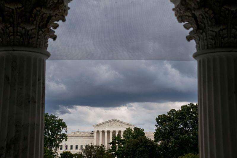 FILE PHOTO: The U.S. Supreme Court is seen through the U.S. Capitol columns in Washington