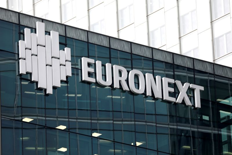 FILE PHOTO: The logo of stock market operator Euronext is seen on a building in the financial