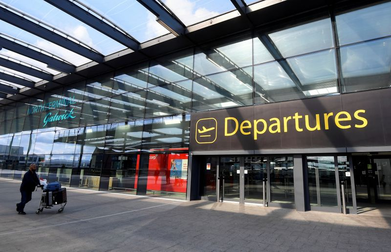 FILE PHOTO: A passenger arrives at Gatwick Airport, in Gatwick