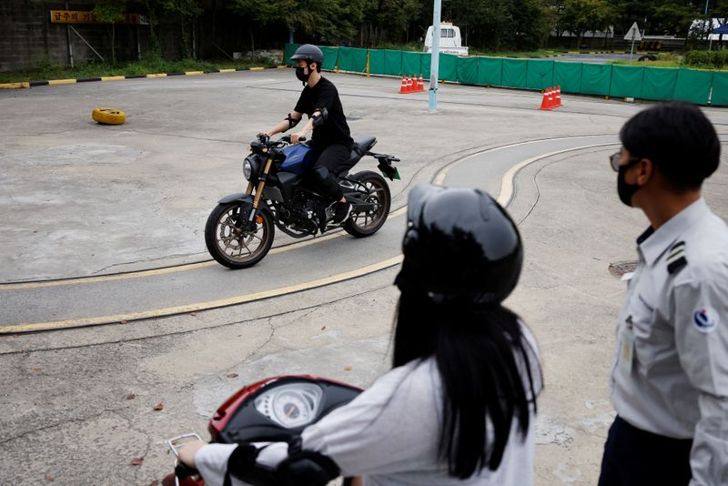 You Young-sik takes motorbike training sessions amid the coronavirus disease (COVID-19)