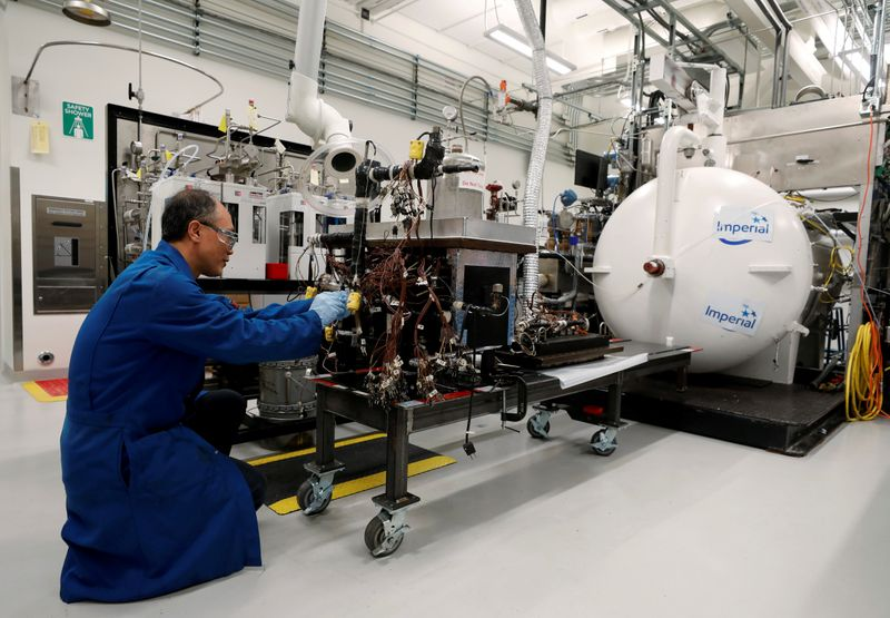 FILE PHOTO: Experiment to get bitumen out of oil sands at the Imperial Oil research lab in