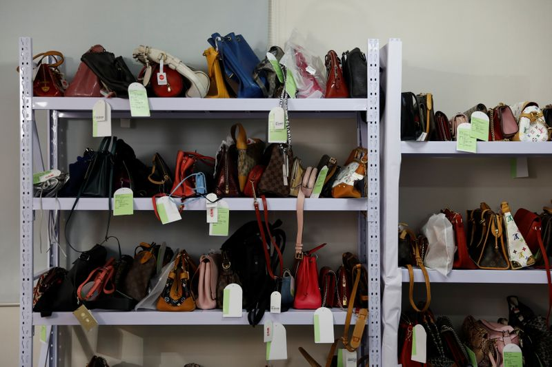 Handbags are seen on shelves during a livestreaming session for the second-hand luxury goods
