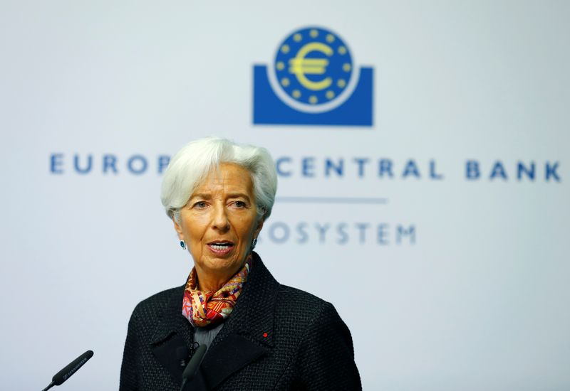 European Central Bank (ECB) President Lagarde gives a signature for newly printed euro