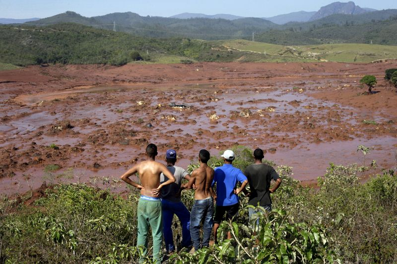 FILE PHOTO: Residents observe the Bento Rodrigues district covered with mud after a dam owned
