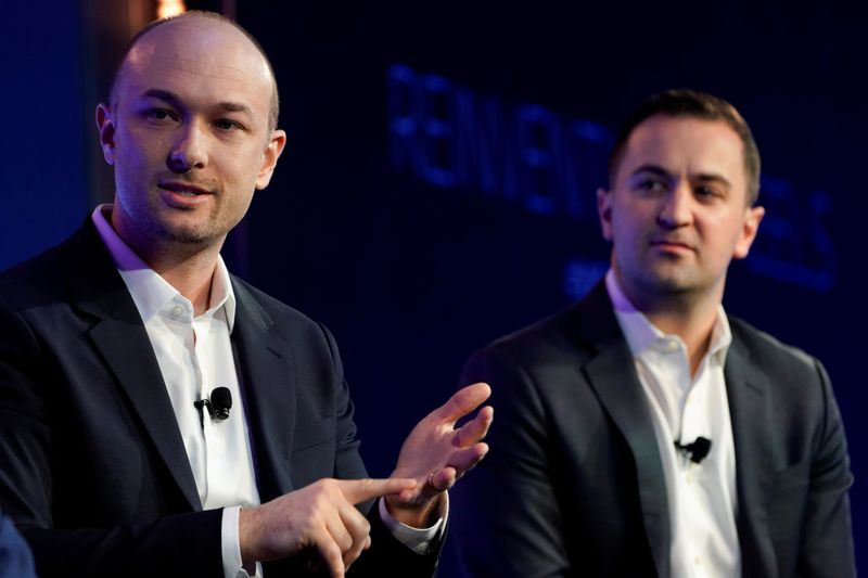 FILE PHOTO: Lyft's cofounders, Green and Zimmer, speak at the 2019 WSJTECH live conference in