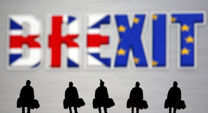 FILE PHOTO: Small toy figures are seen in front of a Brexit logo in this illustration picture