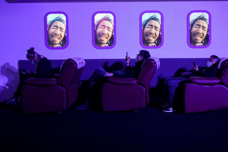 People look at their phones during Alibaba Group's 11.11 Singles' Day global shopping festival