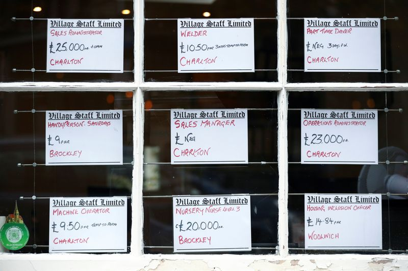 Adverts are seen in the window of a job agency in London