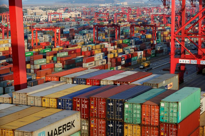 FILE PHOTO: Container boxes are seen at the Yangshan Deep Water Port, part of the Shanghai Free